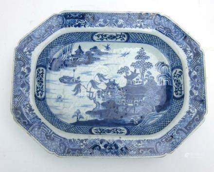 An 18th century Chinese blue and white dish of canted rectangular form decorated in the 'Willow'