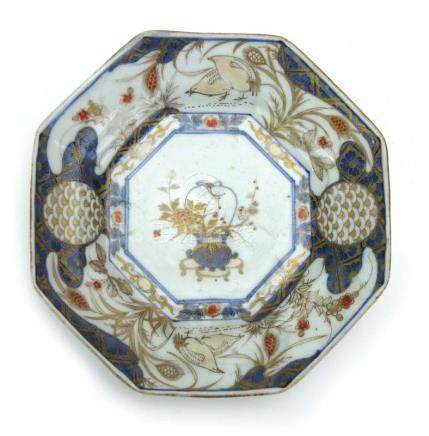 An 18th century Japanese Imari plate of octagonal form, centrally decorated with a vase of flowers,