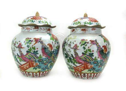 A pair of Chinese covered vases of squat ovoid form decorated in coloured enamels with exotic birds,