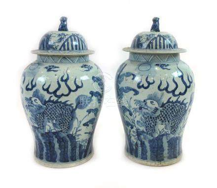 A pair of Chinese blue and white ginger jars and covers of shouldered form decorated with dragons