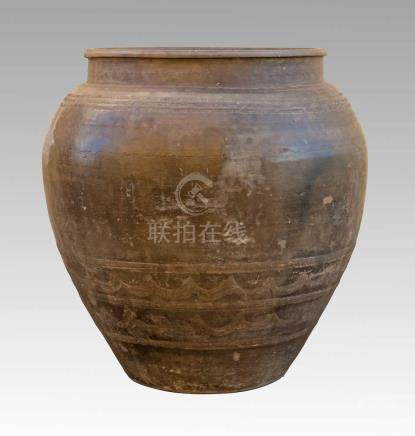 A CHINESE GRAIN STORAGE VESSEL, SHANXI, QING DYNASTY, 19TH CENTURY The massive bulbous body rising