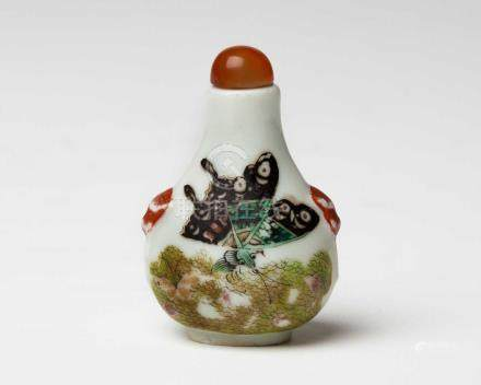 A CHINESE FAMILLE ROSE 'BUTTERFLY' SNUFF BOTTLE, QING DYNASTY, 19TH CENTURY The pear-shaped body