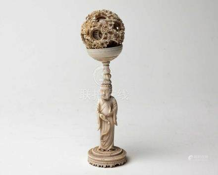 A CHINESE CANTON CARVED IVORY PUZZLE BALL AND STAND, QING DYNASTY, 19TH CENTURY NOT SUITABLE FOR