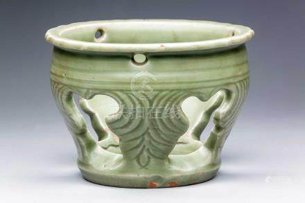 A CHINESE LONGQUAN CELADON RETICULATED STAND, EARLY MING DYNASTY, 14TH / 15TH CENTURY The ovoid body