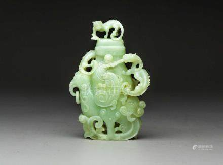 A CHINESE HARDSTONE ARCHAISTIC 'PHOENIX' VASE AND COVER The pale-celadon coloured vessel carved