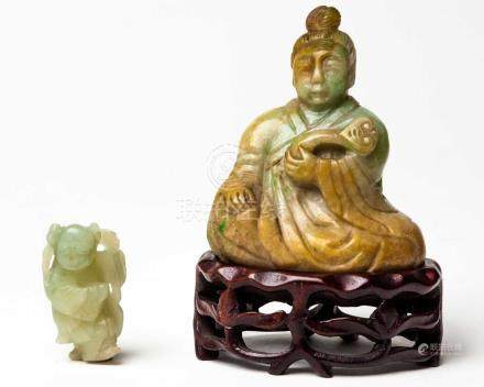 A CHINESE JADEITE FIGURE OF AN IMMORTAL, EARLY 20TH CENTURY The seated figure clad in flowing robes,