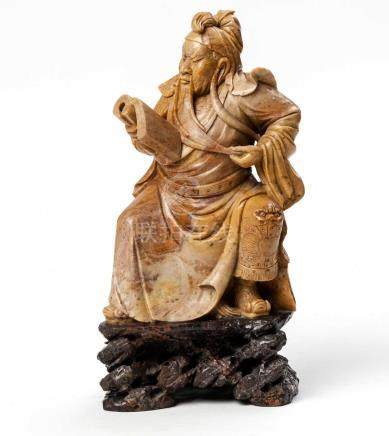 A CHINESE SHOUSHAN CARVING OF THE IMMORTAL 'GUANDI', LATE REPUBLIC PERIOD, 1912-1949 Seated on