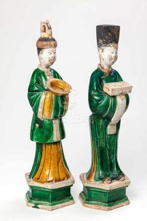 A PAIR OF CHINESE SANCAI-GLAZED POTTERY FIGURES OF ATTENDANTS, MING DYNASTY, 1368-1644 Each standing