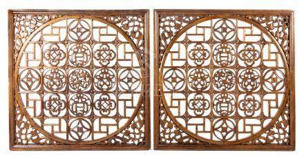 A PAIR OF LARGE CHINESE WINDOW SHUTTERS, QING DYNASTY, 19TH CENTURY Each square panel centred by a