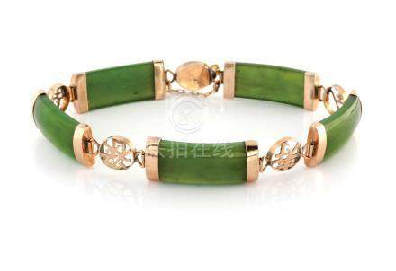 A JADE BRACELET Designed as a series of curved jade panels alternating with circular links pierced