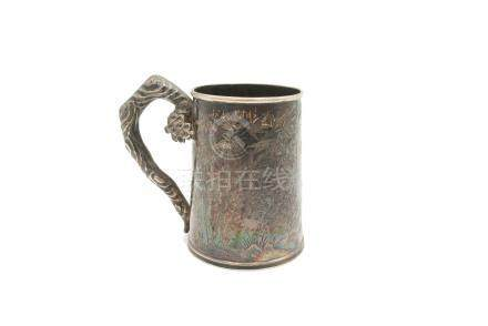 A Chinese silver mug, circa 1900, engraved with flowering trees, birds and bamboo,