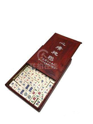 A Chinese mahjong set, early 20th century, with bamboo and ivory tiles,