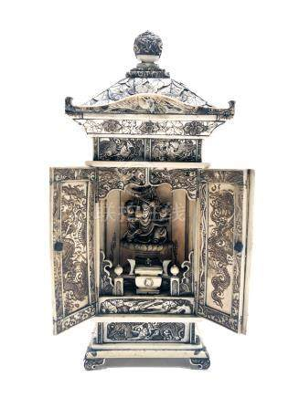 A Japanese carved ivory shrine, late Meiji period, decorated throughout with figures in landscapes,