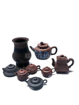 Seven Chinese Yixing teapots, all signed, height of largest 11.