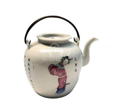 A Chinese famille rose porcelain teapot, early 20th century, with twin metal swing handle,