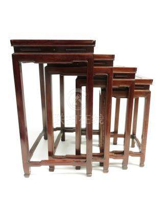 A nest of four Chinese hardwood occasional tables, mid 20th century,