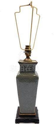 A Chinese celadon crackle glazed vase, converted to a lamp on hardwood base, with gilt metal mounts,