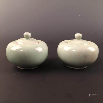 A Pair of Chinese Celdon Glazed Round Box and a Cover