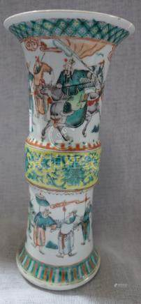 A CHINESE FAMILLE VERTE VASE decorated with figures, 25.5cm high