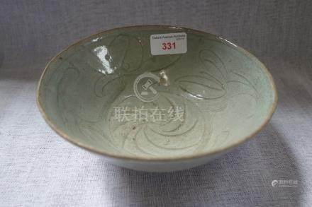 A CHINESE EARLY MING CELADON BOWL with decorated with leaves, 17.5cm dia