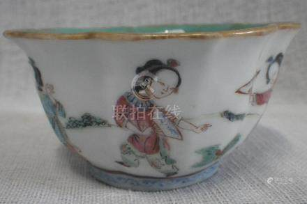A CHINESE FAMILLE ROSE BRACKETED CIRCULAR TEA BOWL decorated externally in famille rose enamels with