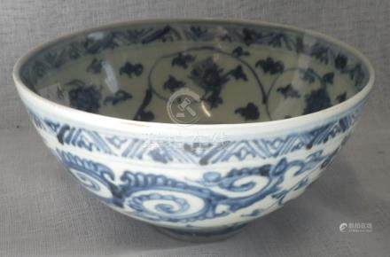 A CHINESE PROVINCIAL BLUE AND WHITE PROVINCIAL BOWL, late Ming Dynasty, 14.5cm dia.