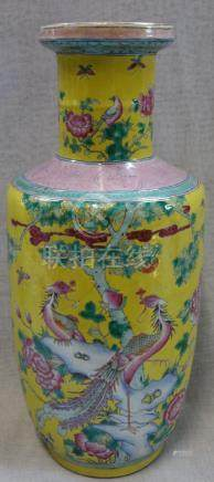 A YELLOW GROUND CHINESE VASE with pink peonies and tropical birds, 44cm high (examine)