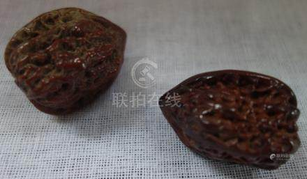 A FINE PAIR OF MATCHING WALNUTS, QING DYNASTY, of similar size and form, 4 cm high
