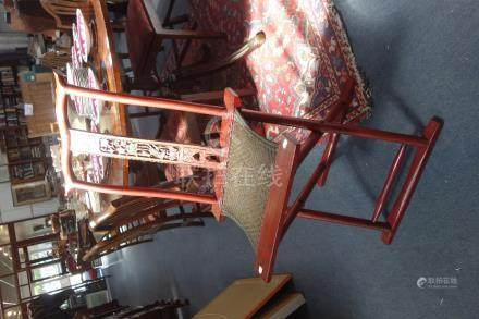 A CHINESE RED LACQUER FOLDING CHAIR, QING DYNASTY, 19TH CENTURY, with a rattan seat, 48cm wide, 98cm
