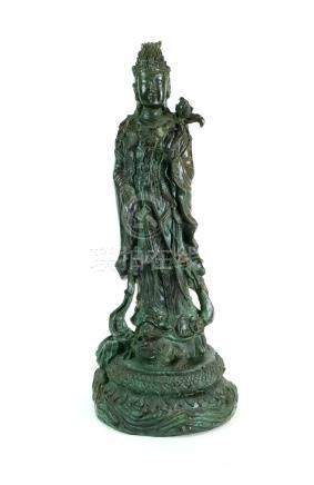 A decorative cast metal figure of Guan Yin, another of the seated Buddha