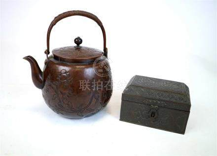 A Japanese hammered copper teapot and a small Arabic copper casket
