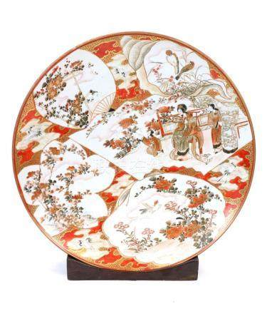 A 19th century Japanese Kutani porcelain charger on stand