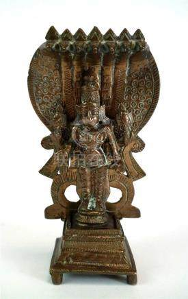 A small Indian cast bronze alter figure in the form of Shiva