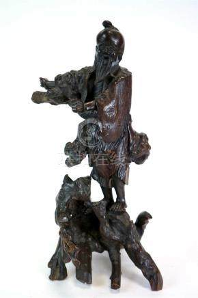 A Japanese Meiji period rootwood carving of a standing sage
