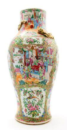A mid 19th Century Cantonese enamel vase, decorated in the famille rose palette with panels of