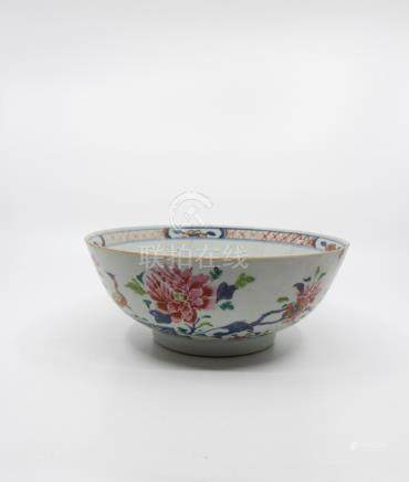 Three Chinese famille rose bowls; the first made for the export market, underglaze blue outlines,