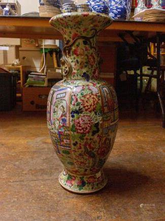 A famille rose canton vase depicting interior scenes of important family, with ladies and