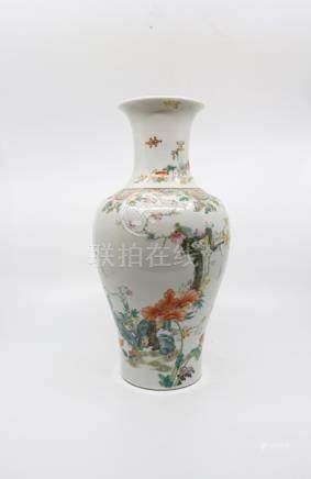 A finely enamelled Chinese famille rose vase, seal mark of Qianlong, of upright baluster form
