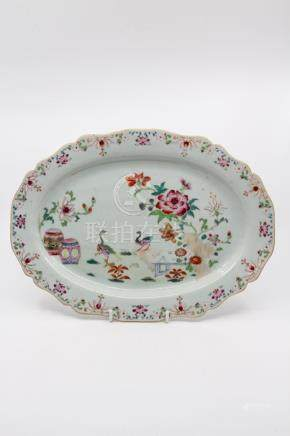 A Chinese famille rose platter, oval form, with ogee rim, Qianlong, geese in garden landscape,