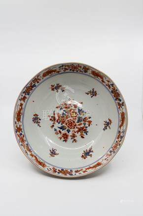 A Chinese porcelain bowl in the Imari palette, floral sprays, sprigs and Carp decoration, Buddhist