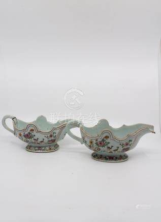 A pair of Chinese export ware European Baroque form sauce boats, each enamelled in famille rose with