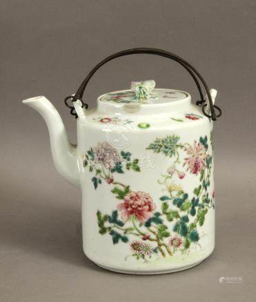 A 20th century Chinese teapot in Famille Rose porcelain