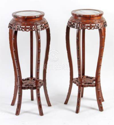 A pair of 20th century Chinese stands in carved wood and marble