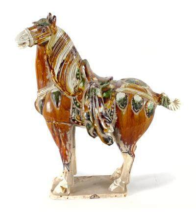 A 20th century Chinese Ming style figure of a horse in polychrome porcelain