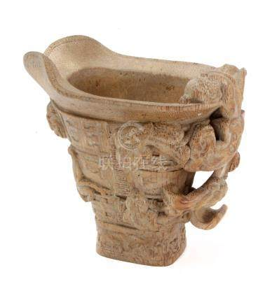 A 20th century libation cup in carved bamboo
