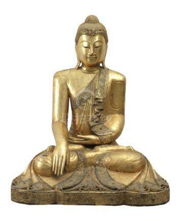 A Burmese sculpture of Buddha from mid-20th century in carved and gilt wood