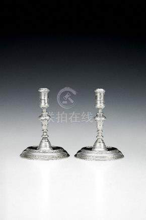 A pair of Queen Anne silver small taper sticks by Pierre Platel