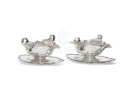 A pair of silver shaped oval sauce boats and stands by S. J. Phillips Ltd