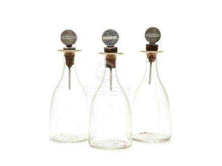 A set of three Art Deco silver mounted Webb glass small decanters by Dingley Bros