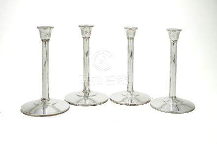 Two pairs of plain silver candlesticks by Theo Fennell